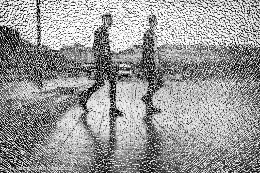 This image would have lost part of it's focus on the two sujects and cracked glass in a color image - Fuji X100S