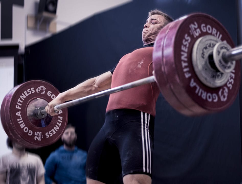 Olympic weightlifter doing a snatch