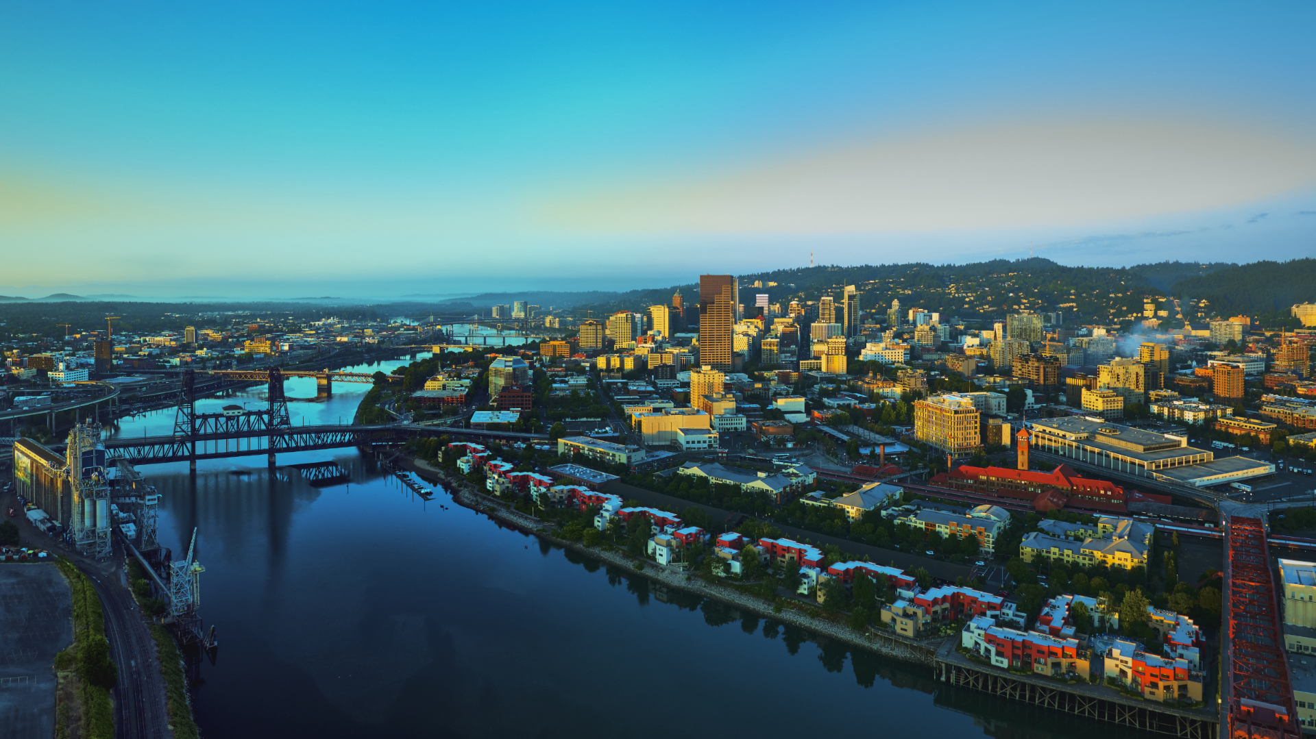 Drone aerial panorama sunrise over downtown Portland with 6 bridges and the Willamette River