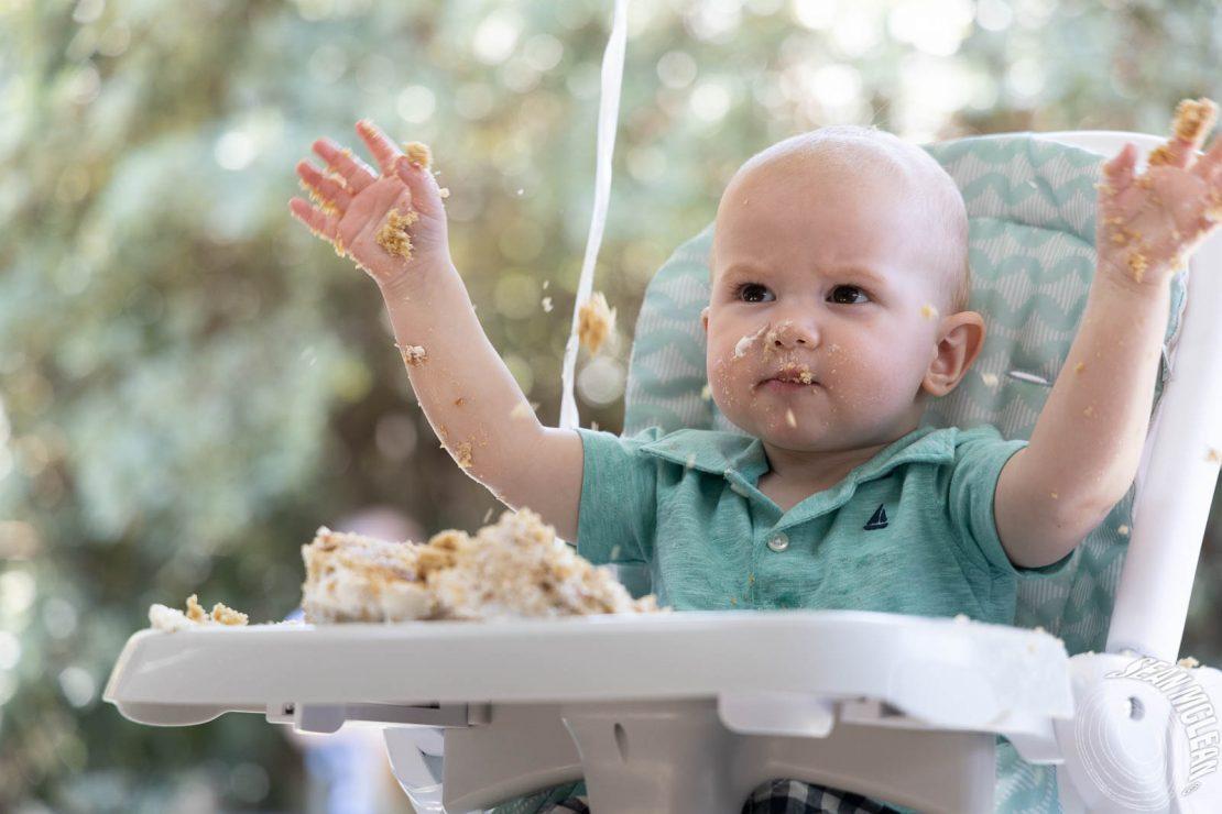 baby boy smashing his birthday cake