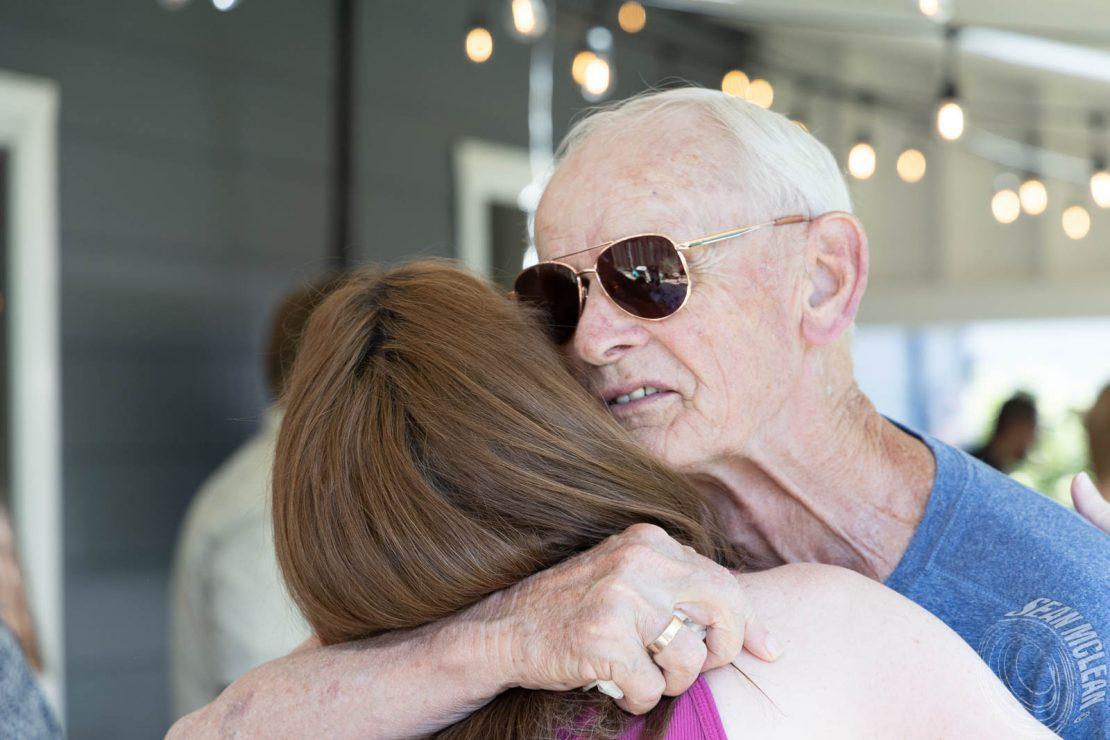 Grandpa hugging his daughter