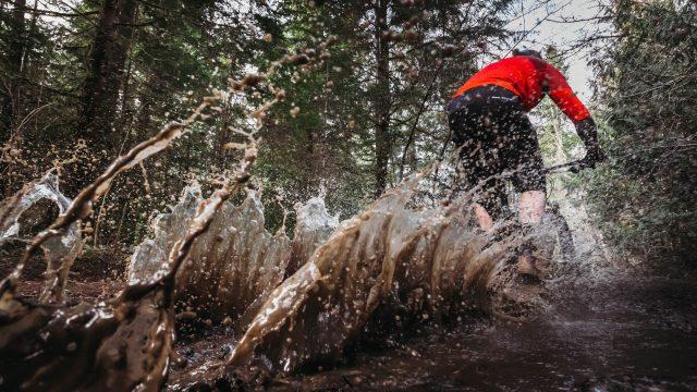 mountain biker splash puddle