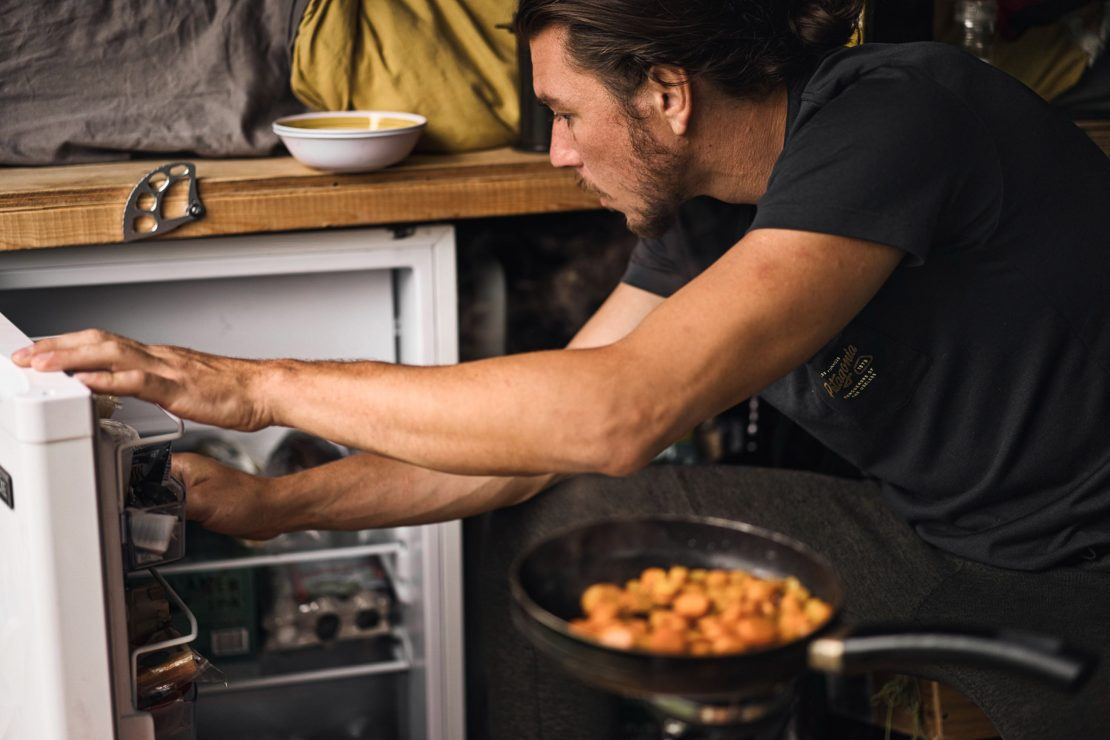 Man cooking in van