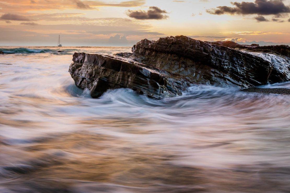 ocean waves around rock
