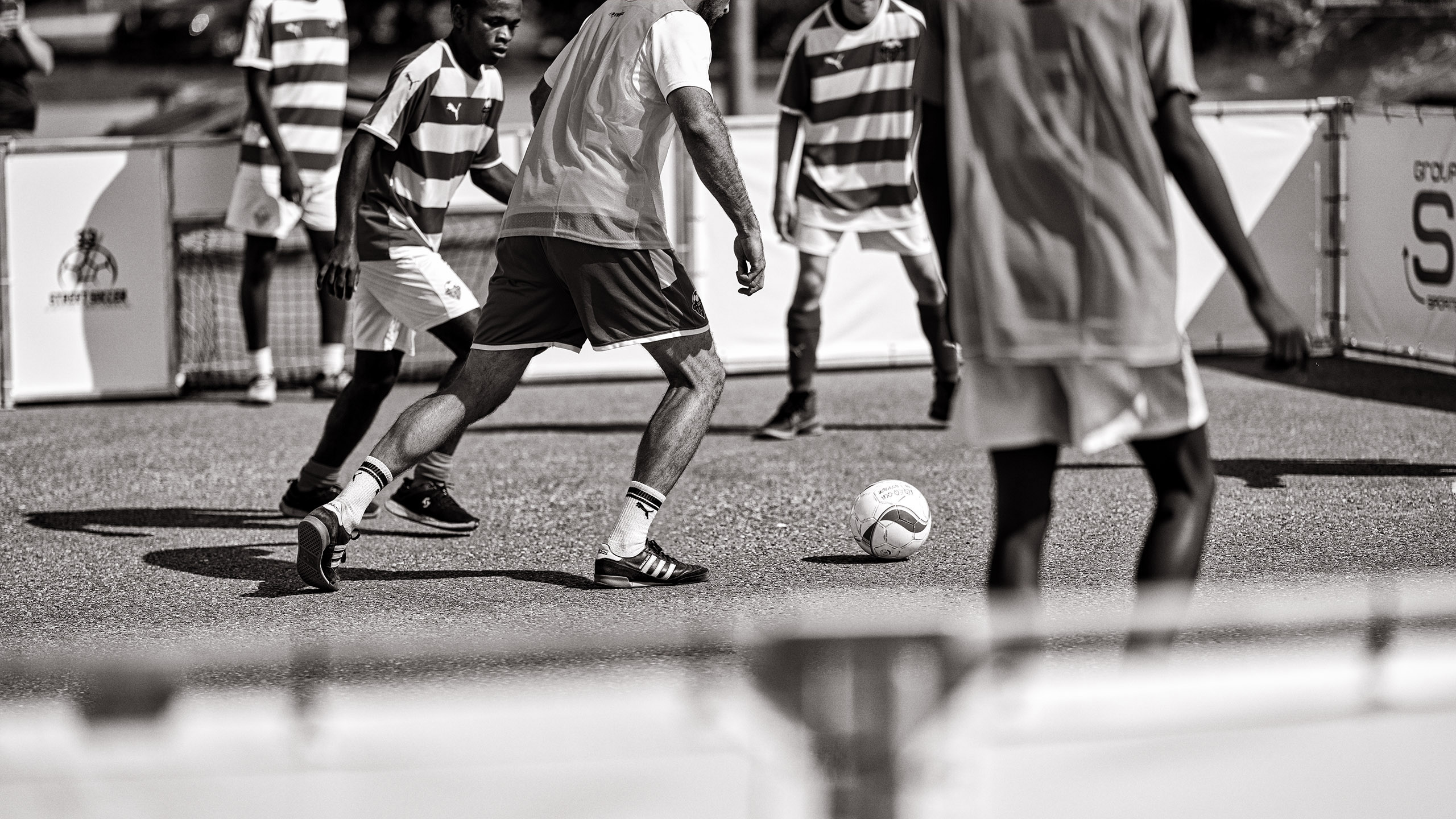 Black and white street soccer players