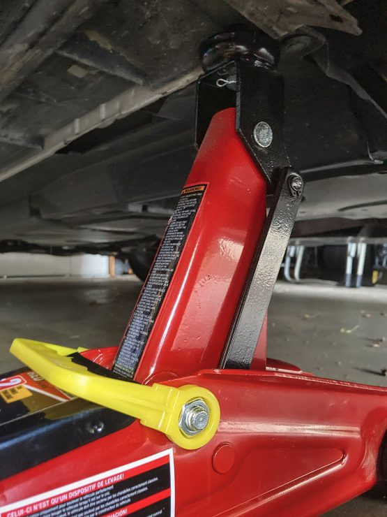 This is my Torin Big Red 2-ton floor jack, which I used to fix my flat in the desert. I also had the car's scissors jack with me in case that was for some reason better. What I neglected to bring was plywood to stop this floor jack from sinking into the sand.