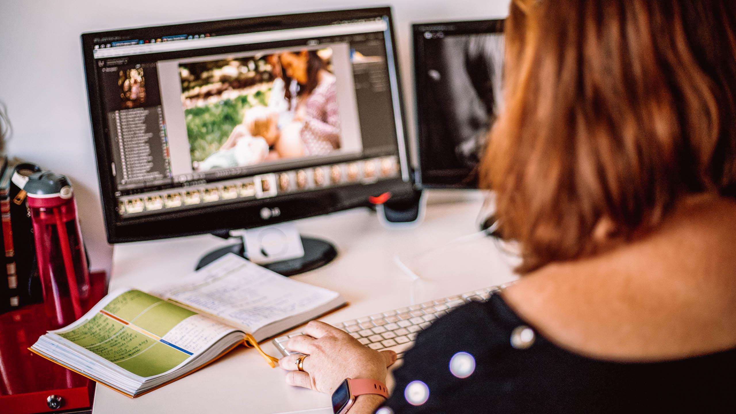 Woman using Lightroom on computer